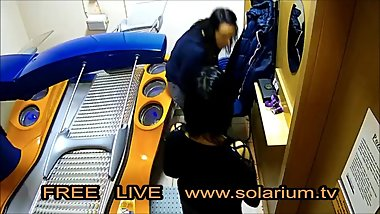 Two hot horny girls with hidden camera filmed in the public solarium