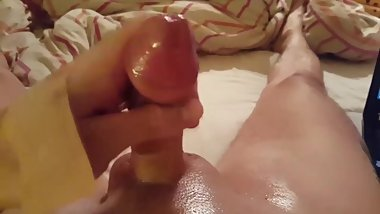 My solo 125 (Wanking my oiled cock and cumming on bed)