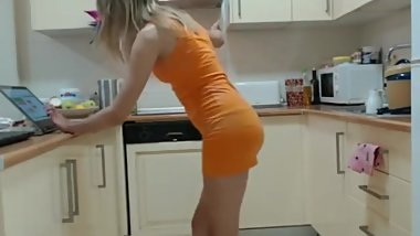 Hot blonde in the kitchen wearing a short tight dress
