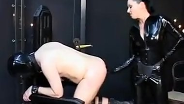 german rubber Mistress femdom and strapon fuck slave