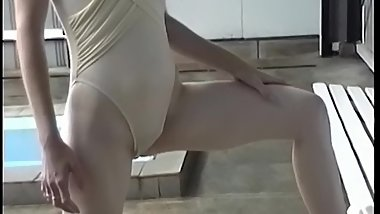 Her swimsuit gives a good cameltoe