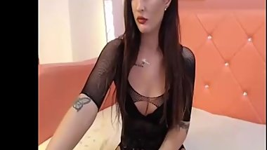 Stunning brunette shemale chats on webcam